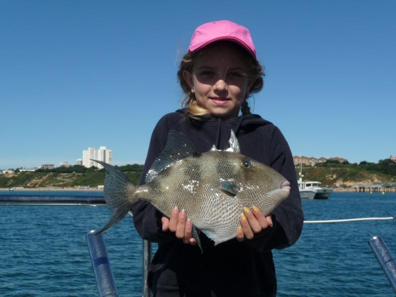 lymington-junior-angler-flora-with-a-trigger-fish