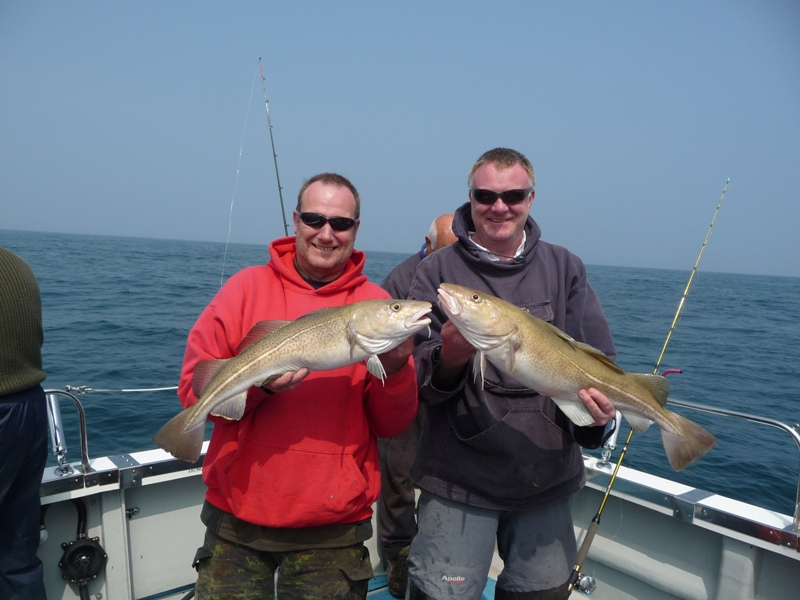 Happy anglers on this wreck fishing trip Dorset